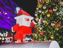 Close up Santa Claus Toys with light bokeh Christmas Tree background stock photography