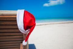 Close-up of santa hat on chair longue at tropical Stock Photography