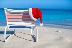 Close up Santa hat on chair longue at tropical Royalty Free Stock Photo
