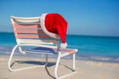 Close up Santa hat on chair longue at tropical Stock Photos