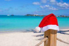 Close-up Santa hat on fence at tropical caribbean Royalty Free Stock Photography
