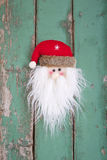 Close up of Santa head on wooden background for christmas Royalty Free Stock Photos