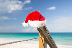 Close up of santa helper hat on beach Royalty Free Stock Photos