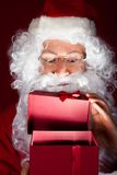 Close-up of santa looking in gift Stock Image
