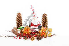 Close up of Santa sitting on wooden horse sledge h Royalty Free Stock Photo