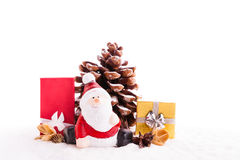 Close up of Santa sitting on wooden horse sledge holding gift an Royalty Free Stock Images