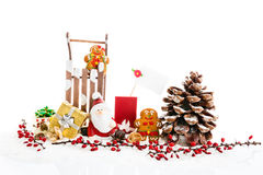 Close up of Santa sitting on wooden horse sledge holding gift an stock images