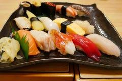 Close up of sashimi sushi set on black plate in Otaru japanese restaurant Stock Photography