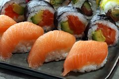 Close up of sashimi sushi set with chopsticks and soy - sushi roll with salmon and sushi roll with smoked eel. Selective focu.s stock images
