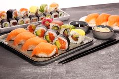 Close up of sashimi sushi set with chopsticks and soy - sushi roll with salmon and sushi roll with smoked eel. Selective focus royalty free stock photo