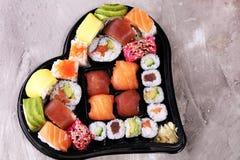 Close up of sashimi sushi set with chopsticks and soy - sushi roll with salmon and sushi roll with smoked eel. Sashimi sushi set with chopsticks and soy for royalty free stock photography