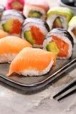 Close up of sashimi sushi set with chopsticks and soy - sushi roll with salmon and sushi roll with smoked eel. Selective focus stock images