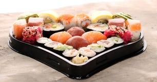 Close up of sashimi sushi set with chopsticks and soy - sushi roll with salmon and sushi roll with smoked eel. Sashimi sushi set with chopsticks and soy for stock images