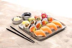 Close up of sashimi sushi set with chopsticks and soy - sushi roll with salmon and sushi roll with smoked eel. Selective focus royalty free stock photography