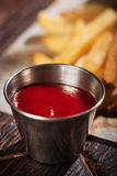 Close up of sauce being served with French fries Royalty Free Stock Photo