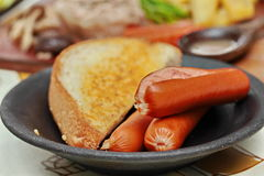 Close up  sausage and bread. Selective focus. Stock Image
