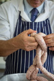 Close up of sausage linking Stock Photography