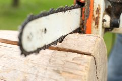 Close-up of a Saw blade from a chainsaw. A Close-up of man cutting with a Saw blade from a chainsaw stock photos