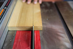 Close up of saw blade cutting wood on table saw Royalty Free Stock Photos