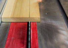 Close up of saw blade cutting wood on table saw Royalty Free Stock Images