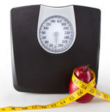 Close up of a scale and a pear Royalty Free Stock Images