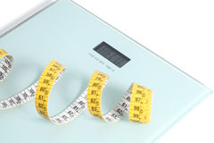 Close up of a scale with a tape measure Royalty Free Stock Photos