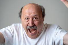 Close up of scared and shocked senior man gesturing in fear with hands and face. Close up portrait of a scared frightened old man in expression of fear in human royalty free stock photos
