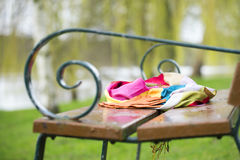 Close up of  a scarf on the bench. In the spring warm beautiful day Royalty Free Stock Photo