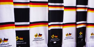 Close up of scarves with the colors of German Flag royalty free stock photos