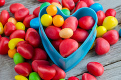 Close-up of scattered candies with blue baking form Royalty Free Stock Photography