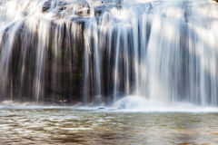 Close-up scenic waterfall flowing on stone, Thailand Royalty Free Stock Photography