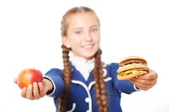 Close up of school girl with apple and hamburger Royalty Free Stock Photography
