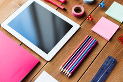 Close up of school supplies and tablet pc. Education, school supplies, art, creativity and object concept - close up of stationery and tablet pc computer on Stock Photo