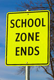 Close Up of School Zone Ends Sign Against Sky Background With Tree Royalty Free Stock Photo