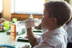 Close-up of schoolboy drinking water Royalty Free Stock Image