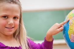 Close up of a schoolgirl pointing at a country Stock Images