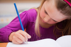 Close up of a schoolgirl writing Royalty Free Stock Photo