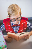 Close-up of schoolkid pretending to be a teacher in classroom. At school Royalty Free Stock Photos