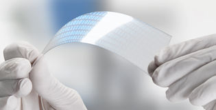 Close up of a scientific holding one piece transparent of graphene application with binary numbers. royalty free stock image
