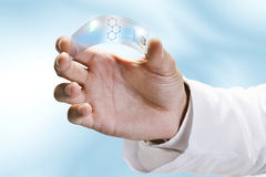 Close up of a scientific holding one piece transparent of graphene application. Royalty Free Stock Image