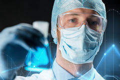 Close up of scientist holding flask with chemical Royalty Free Stock Photography