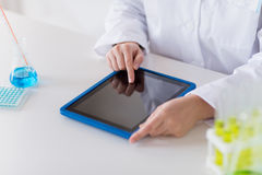 Close up of scientist with tablet pc in lab Royalty Free Stock Photo