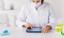 Close up of scientist with tablet pc in laboratory Royalty Free Stock Image