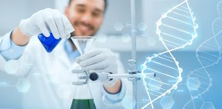 Close up of scientist with test tubes and funnel Stock Photography