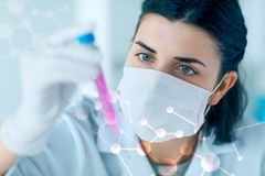 Close up of scientist with tube making test in lab Stock Photography