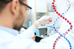 Close up of scientist with tube and pipette in lab Royalty Free Stock Images