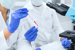 Close up of scientists filling perti dish in lab Stock Photography