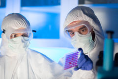 Close up of scientists making test in chemical lab Royalty Free Stock Photos
