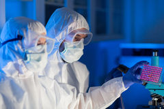Close up of scientists making test in chemical lab Royalty Free Stock Photography