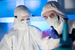 Close up of scientists making test in chemical lab Stock Photo